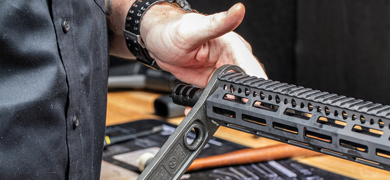 Gunsmitch installing Lantac Dragon 9mm Muzzle Brake on 9mm AR-15 Upper Receiver with Bravo Company MFG MLOK Modular Rail System