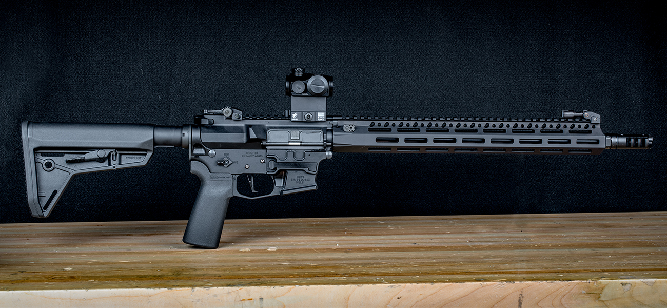 Completed Primary Arms giveaway pistol caliber carbine AR-15 rifle standing on gunsmith workbench