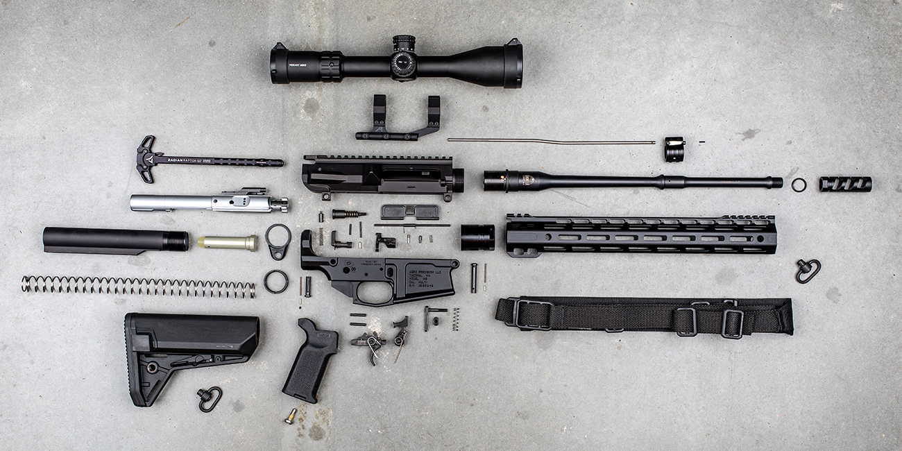 Ar 10 308 rifle with all parts for upper and lower receivers set out
