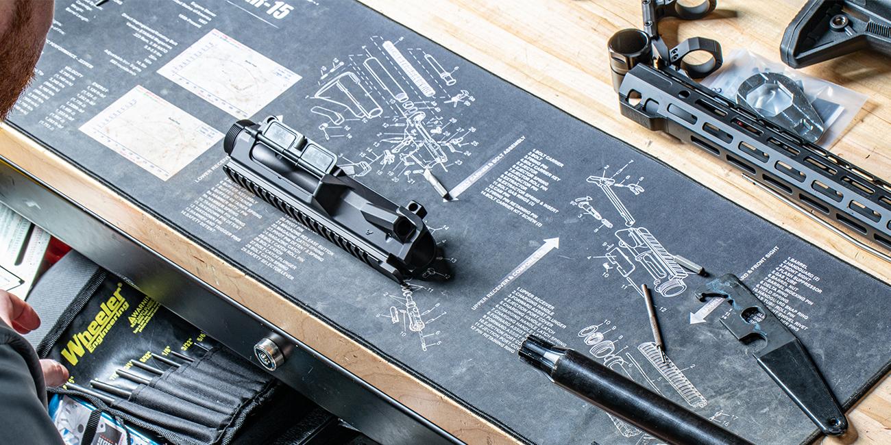 Gunsmith prepares to install barrel to 7.62 AR upper receiver.