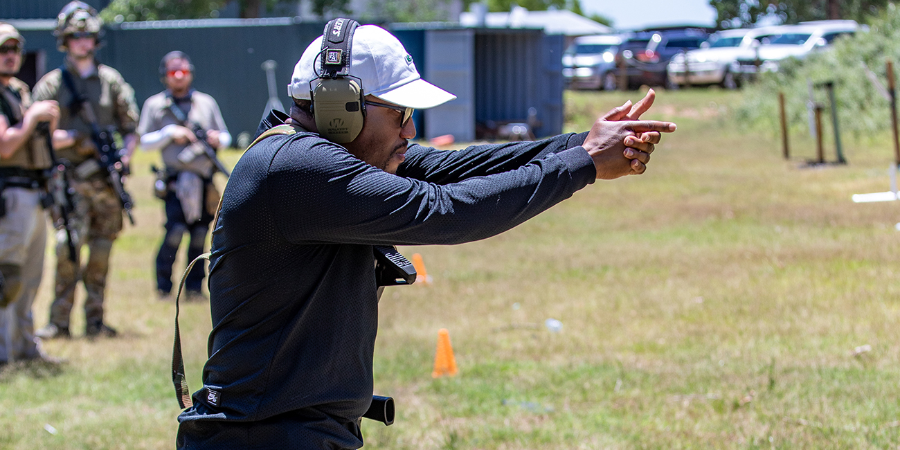 Carbine course student comedically imitates a pistol drill with his finger