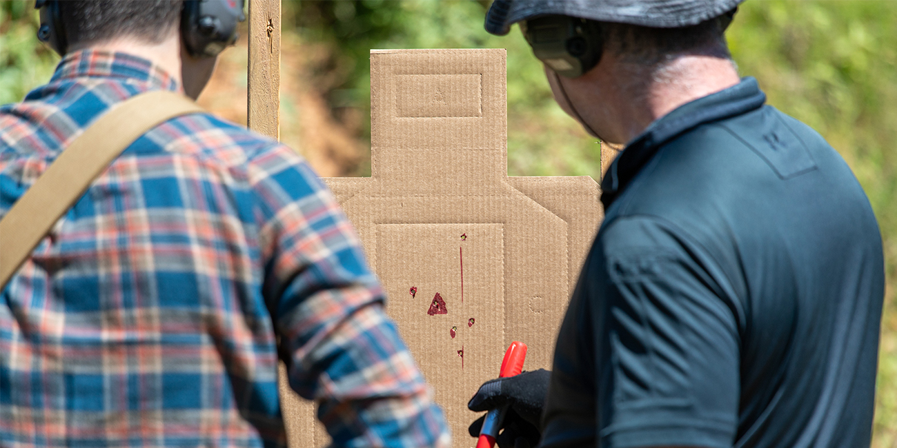 Rifle instructor marks a Cardboard Rifle Target with a marker during an ar15 training course