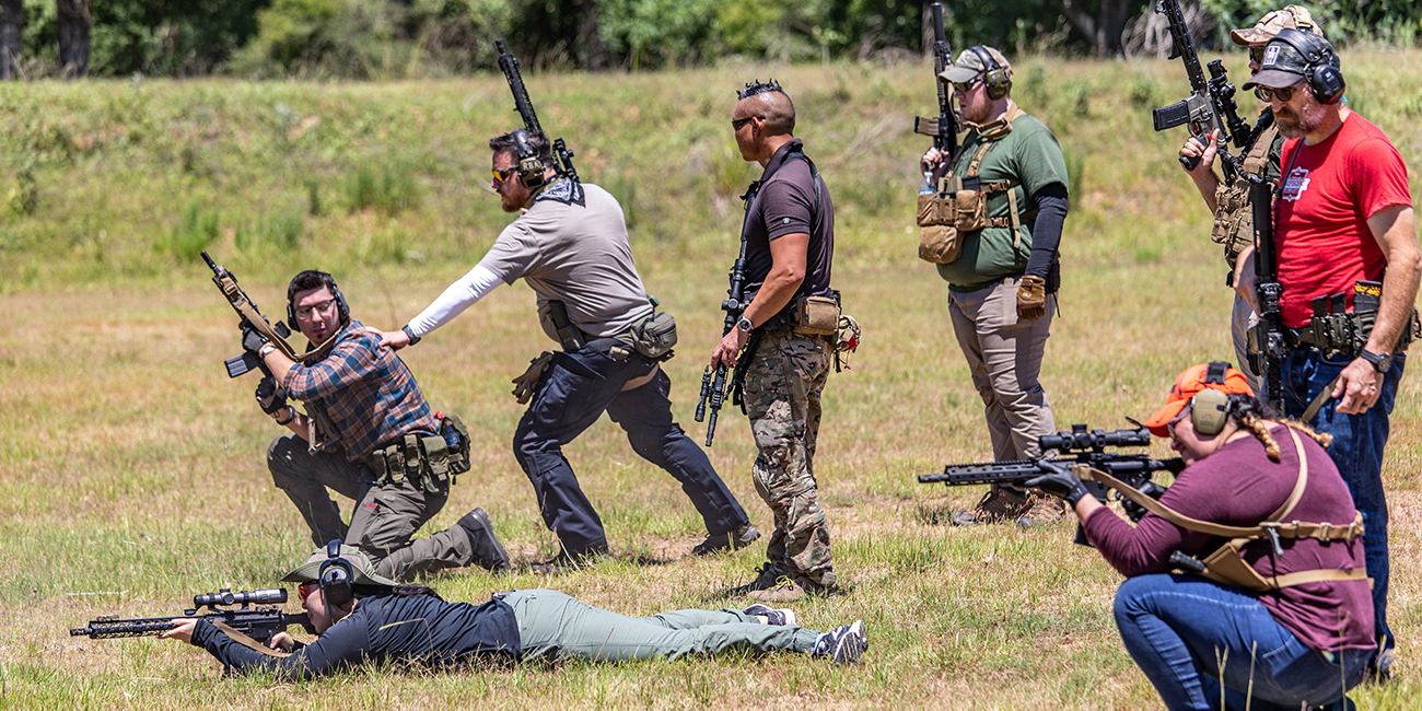 Standing Kneeling and Prone drill with AR 15s in high ready