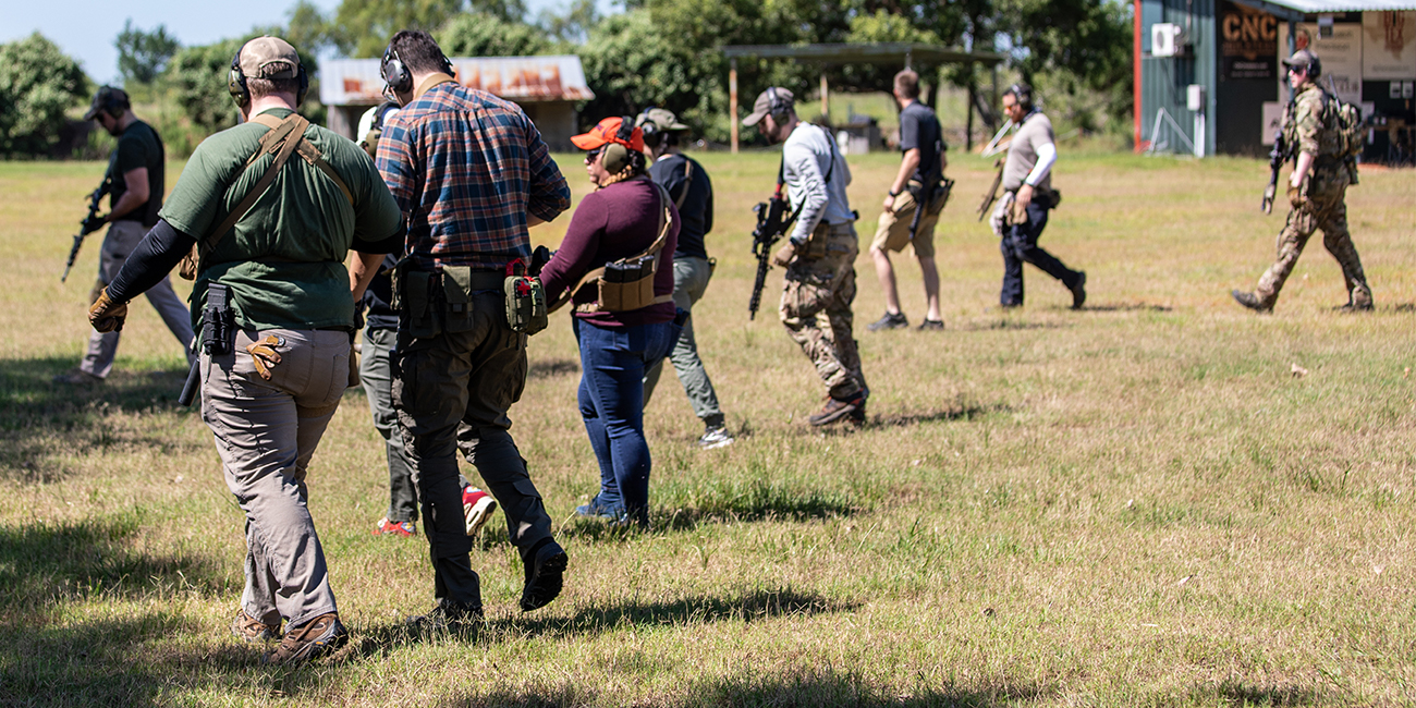 Primary Arms Team walking uprange with rifles slung during MAST Solutions Carbine Course