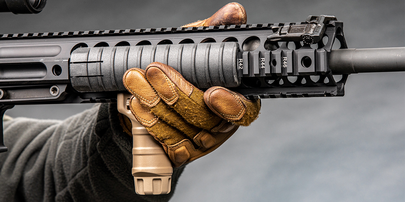 Shooter demonstrates proper form when shooting a stubby vertical grip on an AR 15 or AR 10