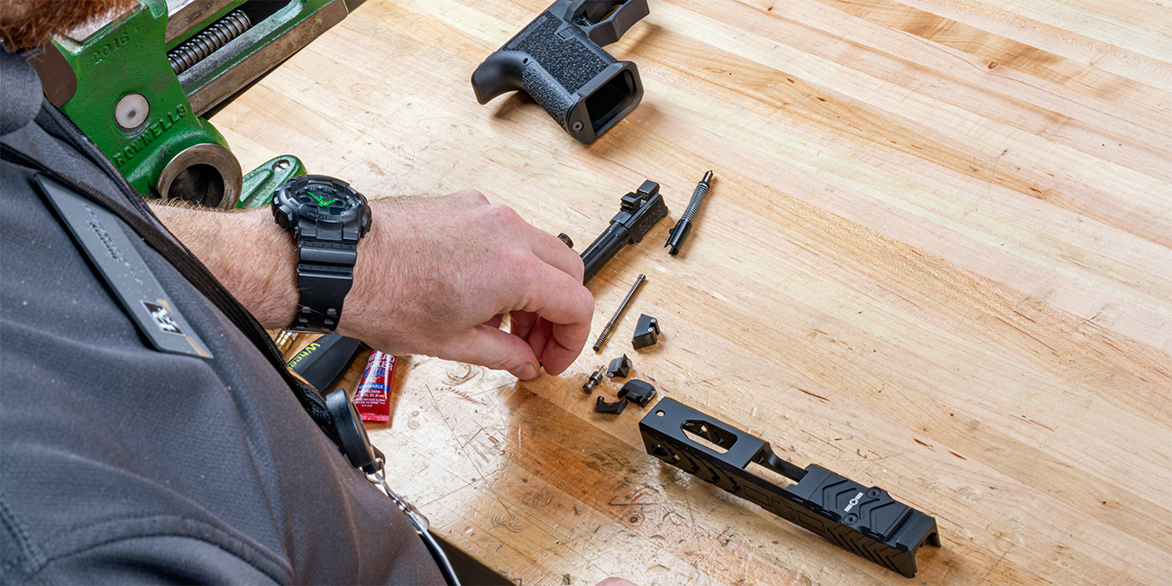 Gunsmith Prepares to assemble EDC Carry Pistol with Polymer 80 Frame and POF Glock 19 Slide