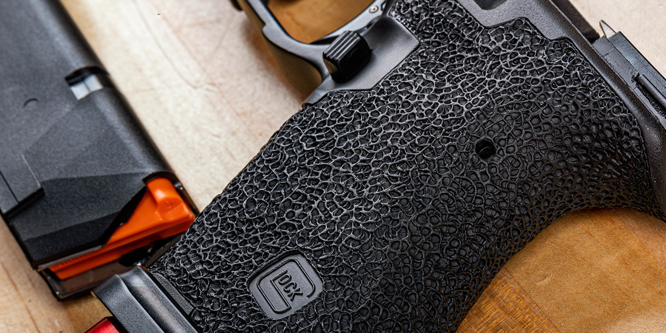 Close up view of Rook Customs Tier 2 Glock 19 Gen 3 Slide with full Stippling.