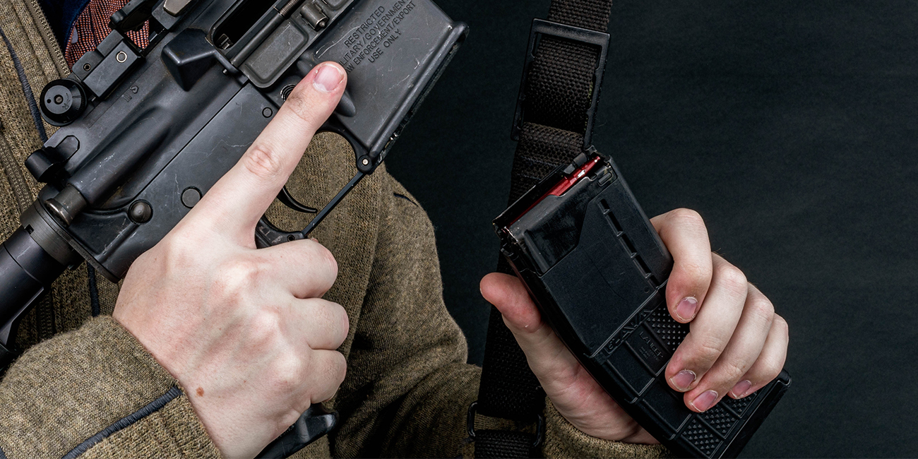 Man removes Lancer AWM 30rd 5.56 Magazine from AR15