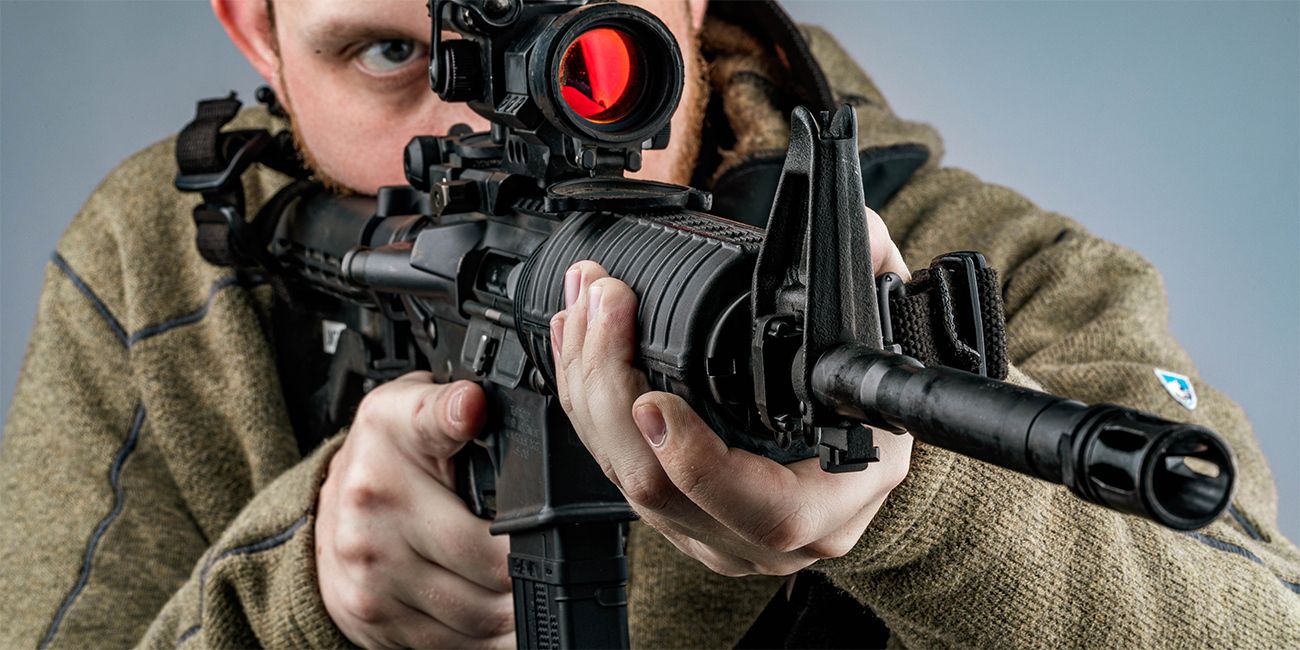 Man shoulders and aims with now-reliable AR15