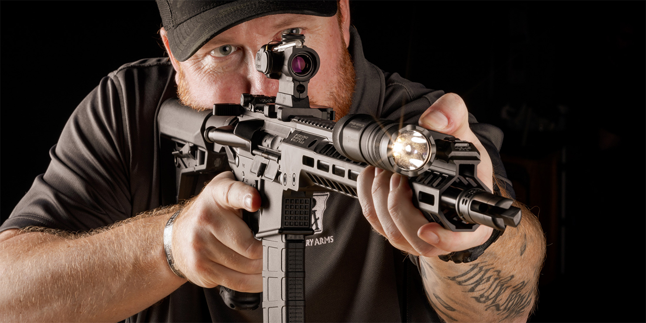Gunsmith looks down a Trijicon 1.5x ACOG TA44 on home defense carbine