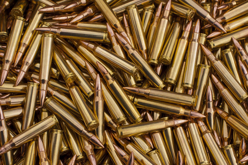 pile of 5.56 ammunition for use in AR15 barrels