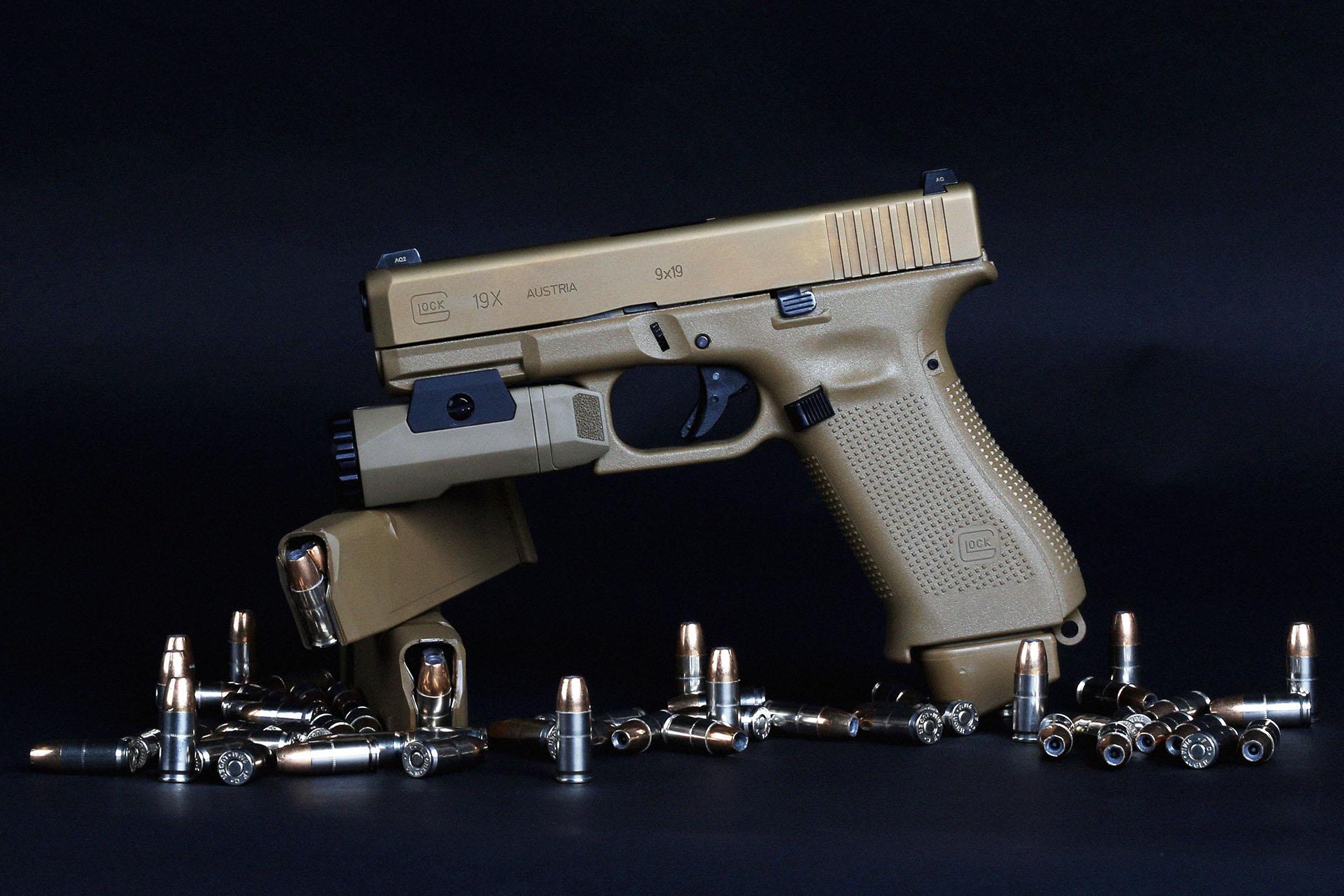Glock 9mm Pistol in flat dark earth with JHP ammunition