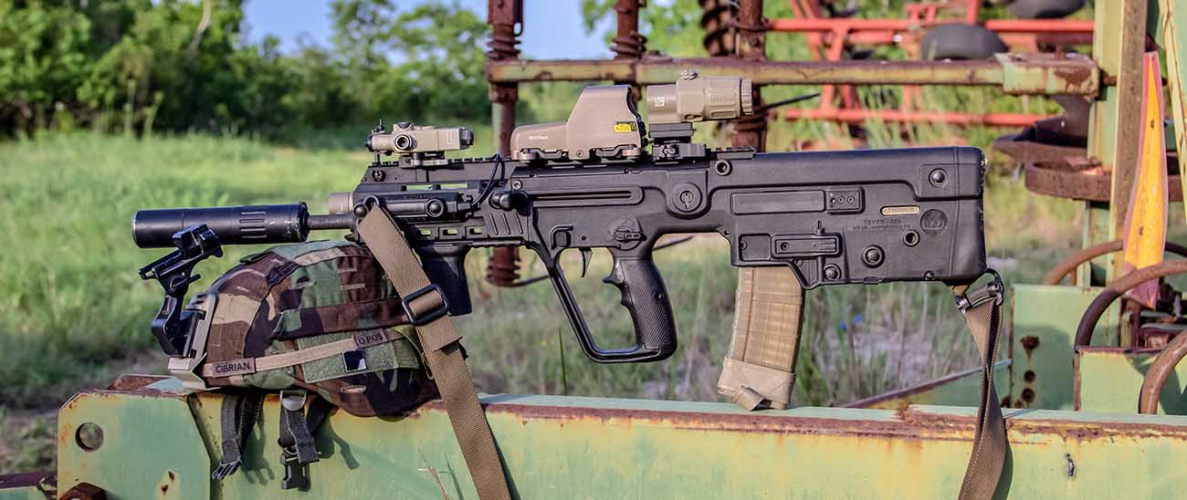 Suppressor IWI Tavor bullpup rifle with EOTech holographic sight and magnifier