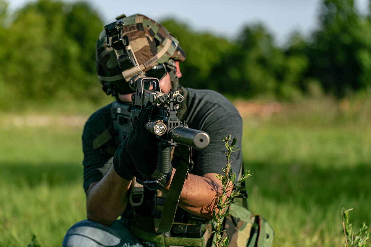 Shooting an IWI Tavor bullpup rifle with a suppressor and EOTech Holographic sight