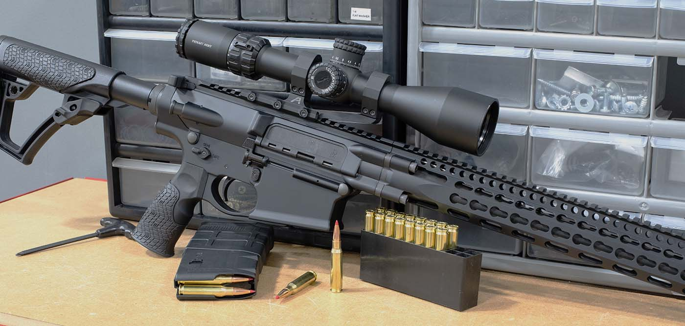 Daniel Defense 7.62x51 / .308 rifle on a work bench with Primary Arms ACSS HUD DMR rifle scope.
