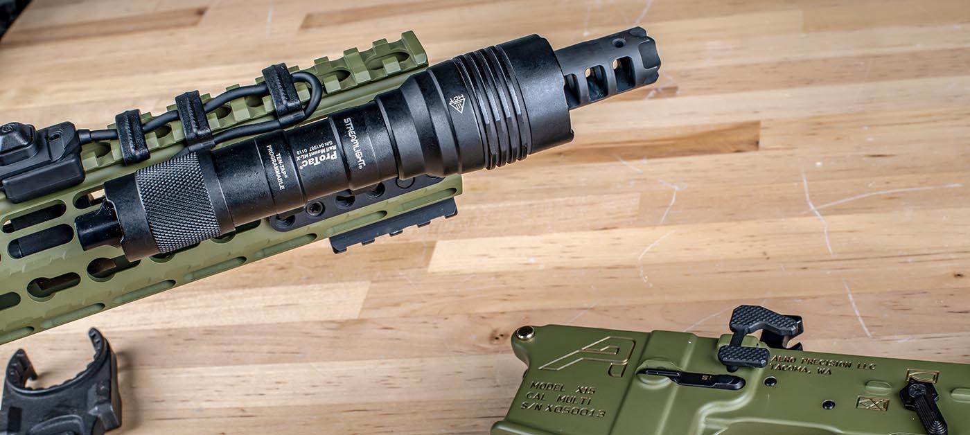 My AR build has a streamlight protac HL-X and a LANTAC dragon muzzle break on the end.