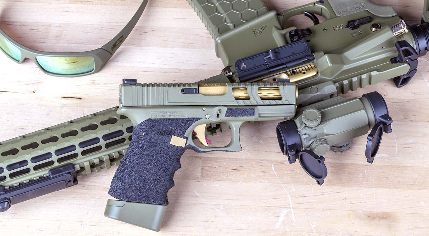 My Oakley Sunglasses and Custom Glock 19, Cerakoted in bazooka green to match my rifle.