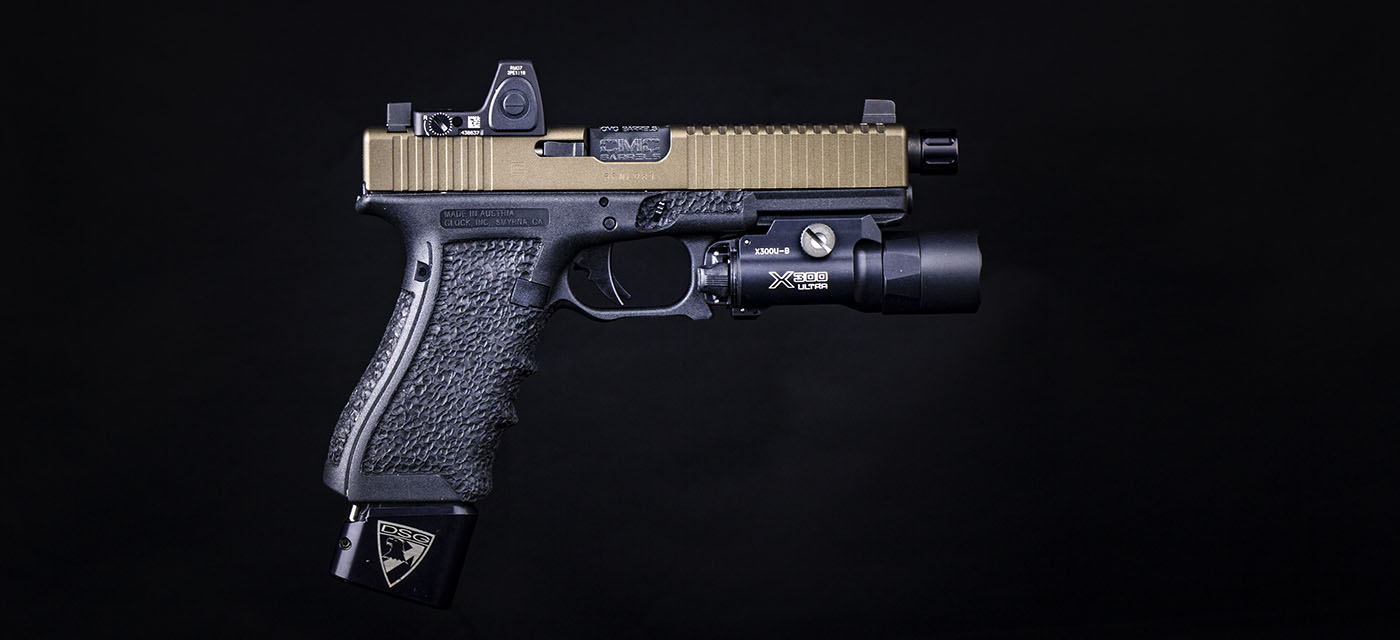 Glock 17 with Trijicon RMR, Stipple lower, and Surefire weapon light.