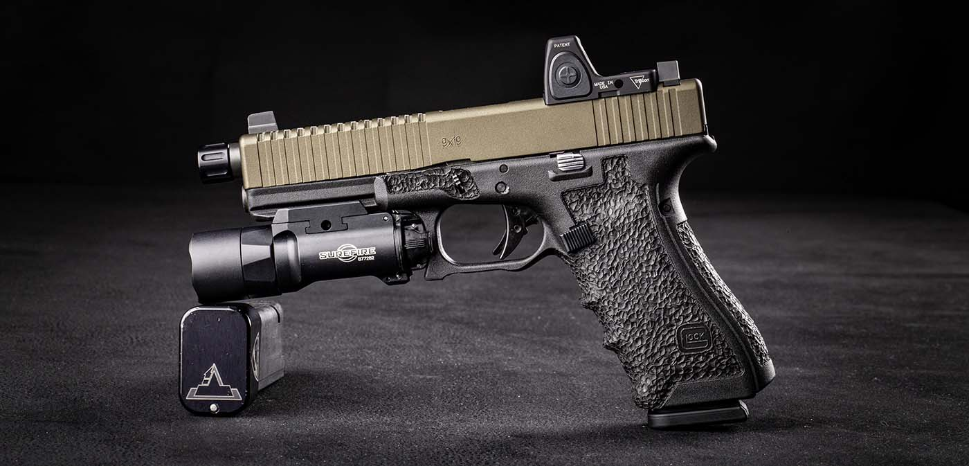 Custom Glock 17, support side profile, featuring custom stippling, red dot, and weapon light.
