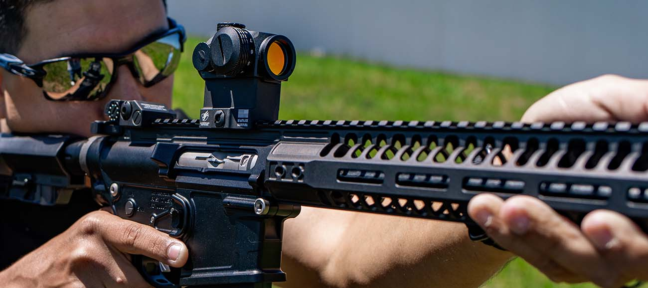 Run an AR-22 with a micro red dot sight and train on the cheap.