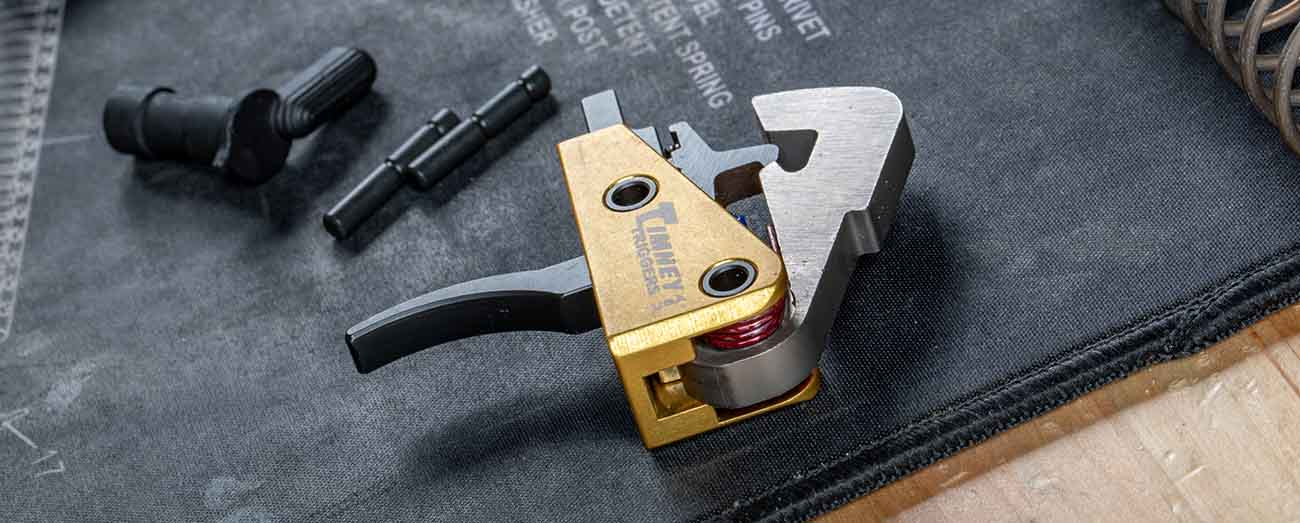 Timney Triggers drop in trigger assembly on work bench.