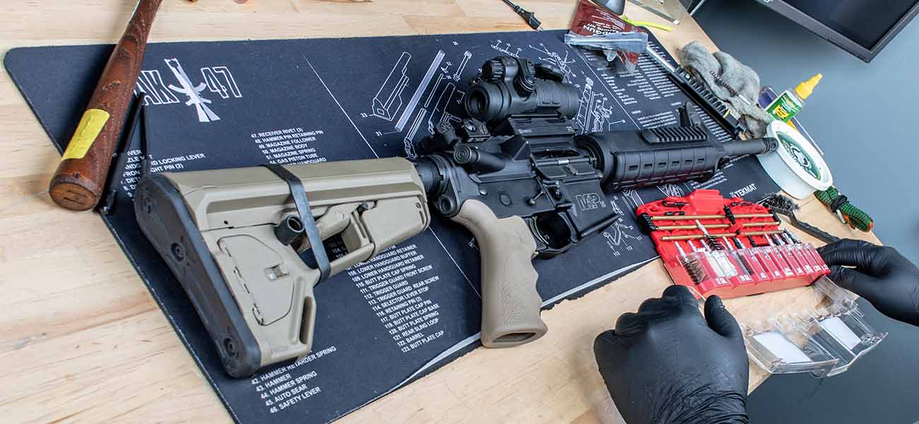 Prep your AR-15 cleaning workspace with a TekMat and a AR-15 cleaning kit.