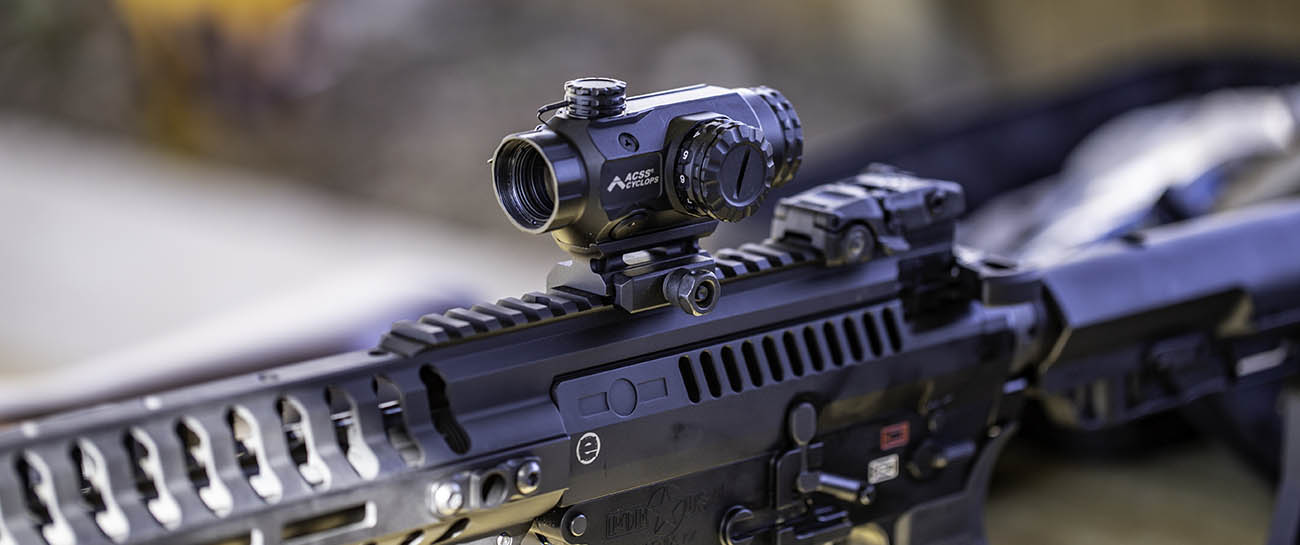 The Primary Arms ACSS Cyclops 1x prism scope is a smart alternative vs red dot sight.