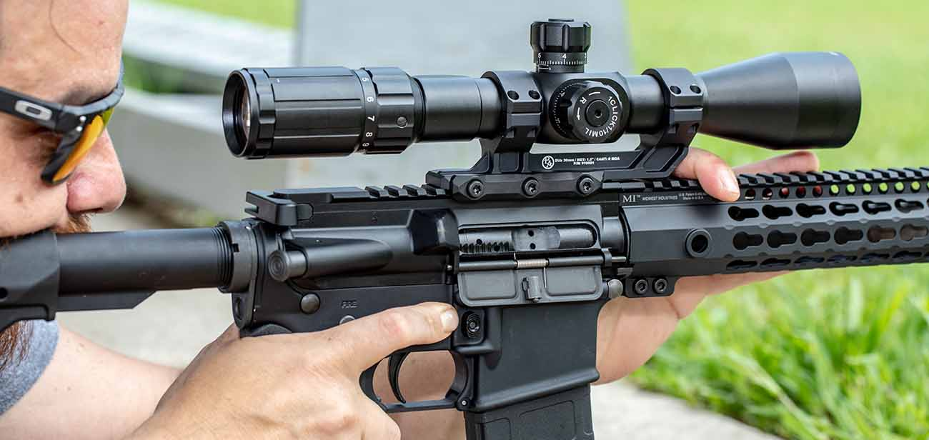 shooting an AR-15 with Primary Arms 4-14 scope and ECS mount.